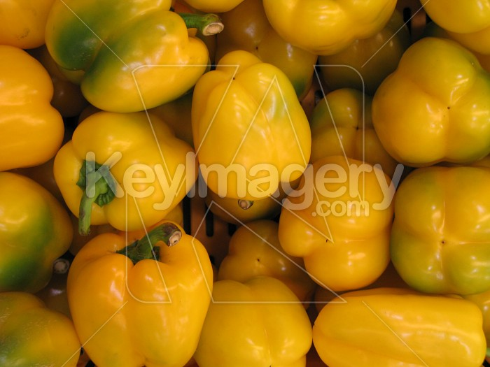 A bunch of yellow capsicums (closer up) Photo #2593