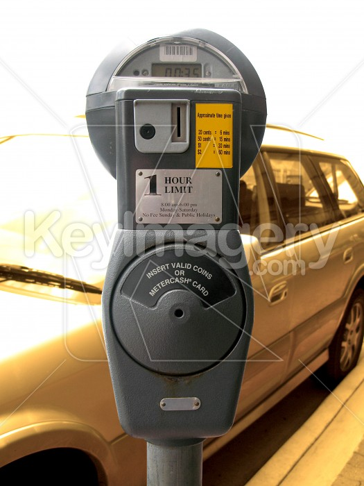 A parking meter with vehicle in background Photo #433