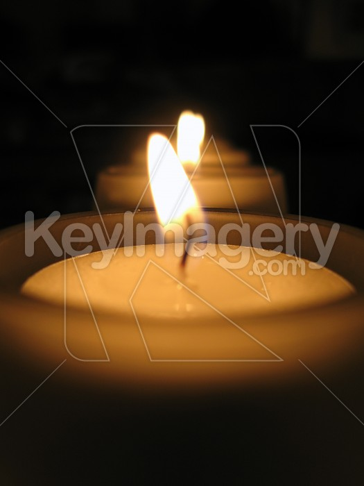 A row of tealight candles lit Photo #2089