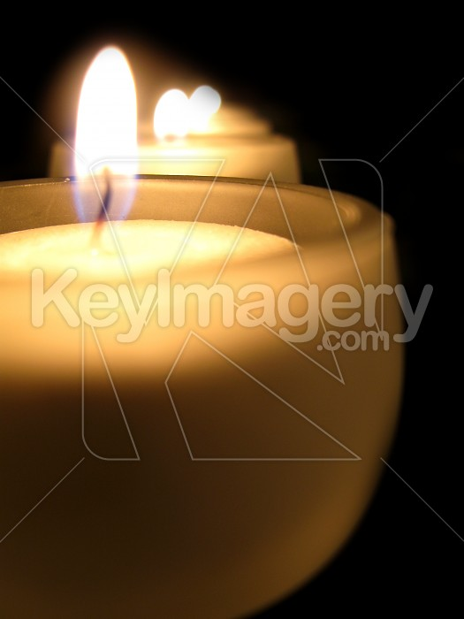 A row of tealight candles lit Photo #2095