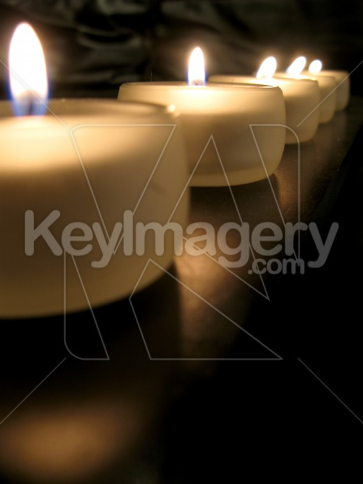 A row of tealight candles lit Photo #2096
