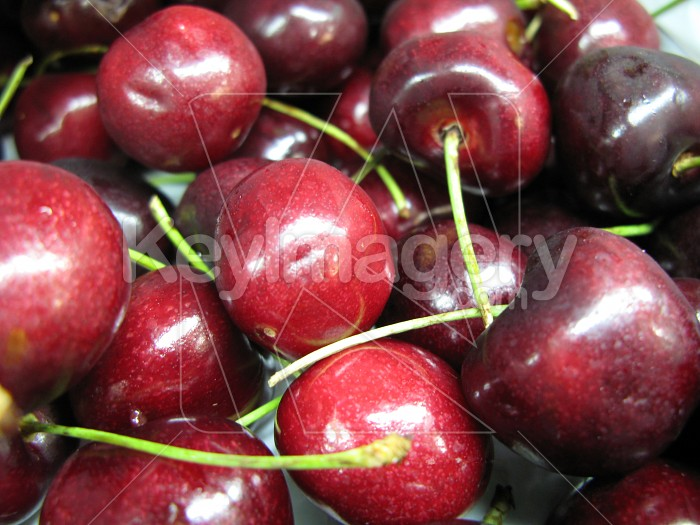 A stack of red or black cherries Photo #2591