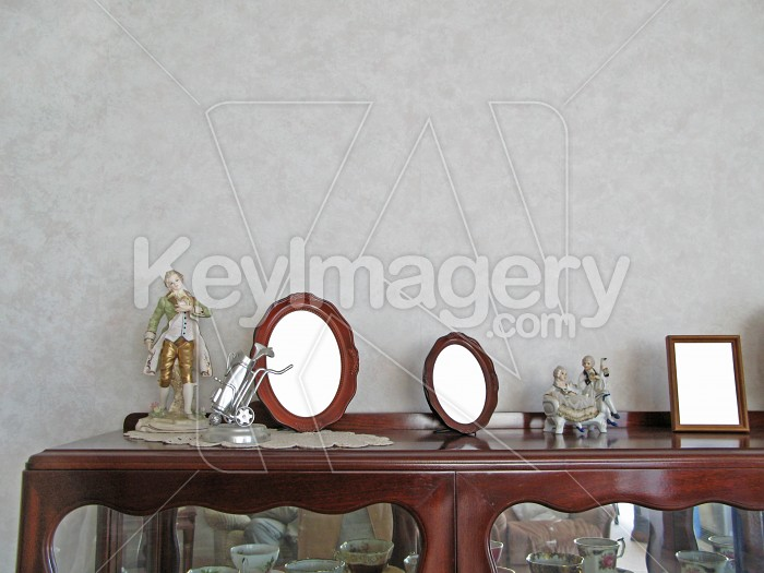 Frames and figurines on china cabinet Photo #2495