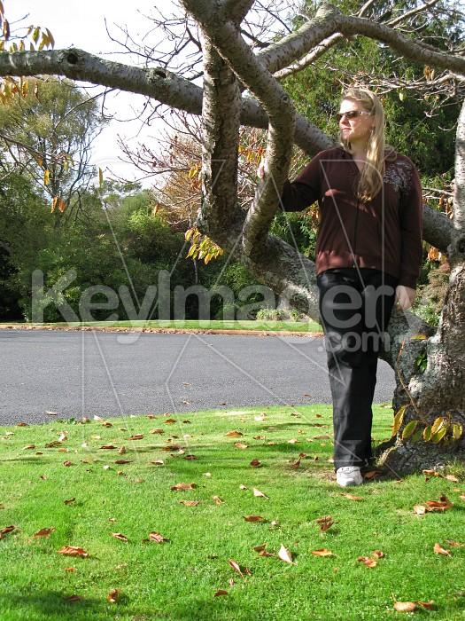 Girl standing near a tree Photo #1491