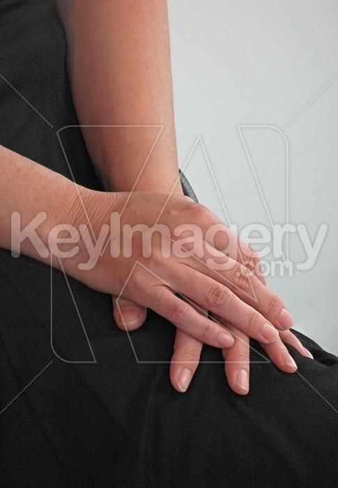 Hands folded on lap Photo #4767