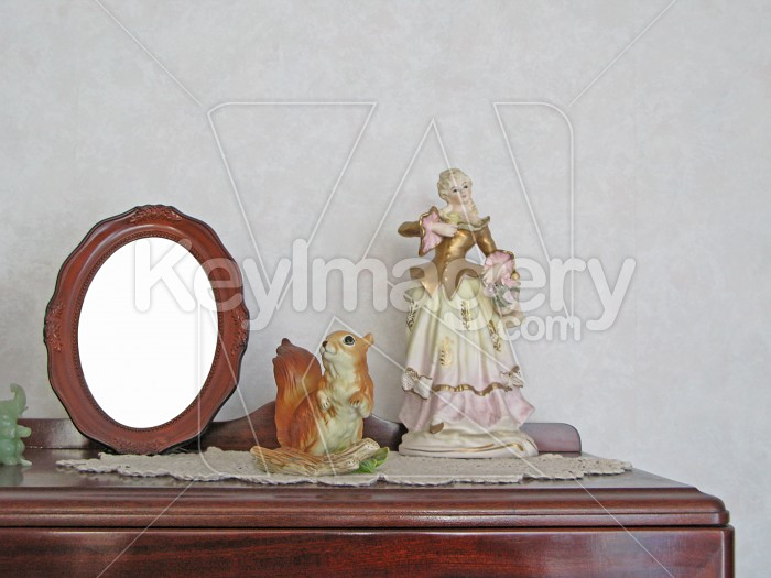 Photo frame and figurines on china cabinet Photo #2497