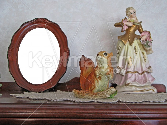 Photo frame and figurines on china cabinet Photo #2498