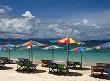 Tropical beach deck chairs and umbrellas