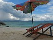 Tropical beach deck chairs and umbrella