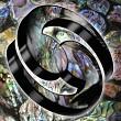 3D Koru shapes on a Paua background