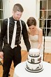Groom and Bride cutting wedding cake