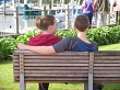 A young couple on a park bench
