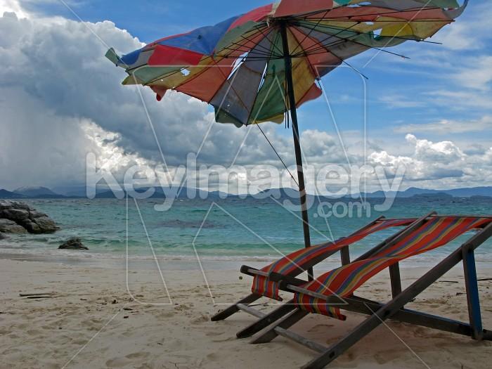 Tropical beach deck chairs and umbrella Photo #14170