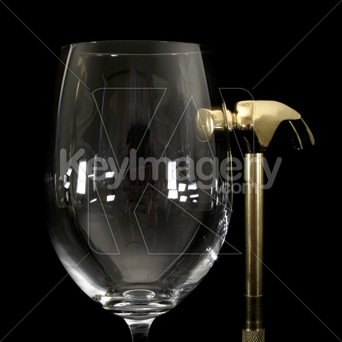 Wine glass and gold hammer Photo #2305