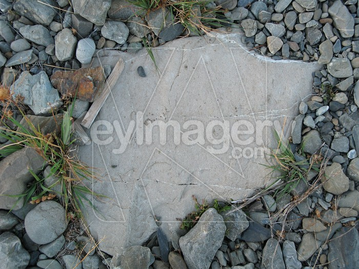 Stone plaque surround by small rocks Photo #12103