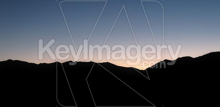 Sunrise silhouette over hills Photo #12101