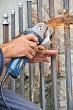 Worker hands with grinder