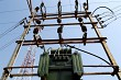 Electric transformer and tower