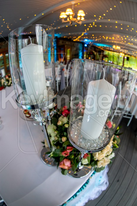 Candles in candlestick and flowers on wedding table Photo #61687