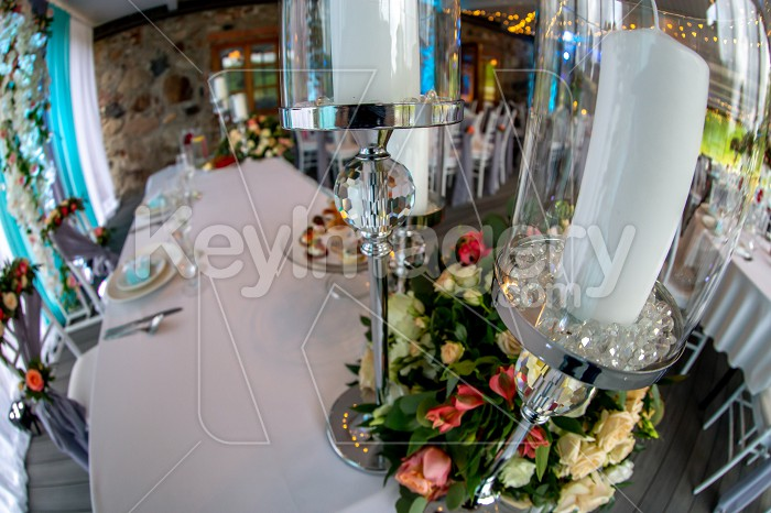 Candles in candlestick and flowers on wedding table Photo #61688