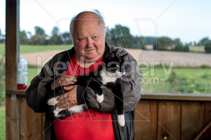 Old man with cat in countryside. Photo #60428