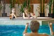 Family in swimming-pool