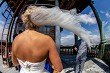 Bride with groom in church on blue sky background.
