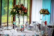 Bouquet of flowers and glasses on the wedding table