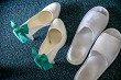 White bridal shoes and white slippers