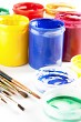 Colourful paints and paintbrushes