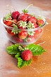 Glass bowl with strawberries