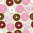 Seamless background of assorted doughnuts