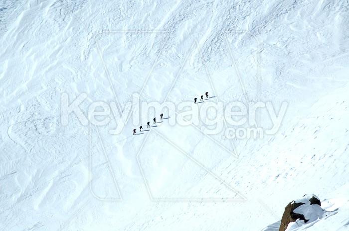 Climbers crossing snow Photo #4479