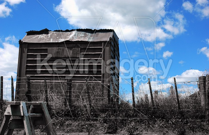 Black and White Tin Shed on Blue Sky Photo #12527