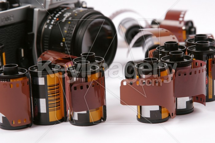 Closeup image of 35mm films and a SLR Camera Photo #7557