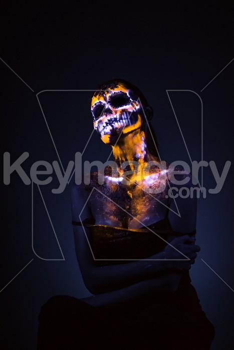Girl's face painted UV skull Photo #59598
