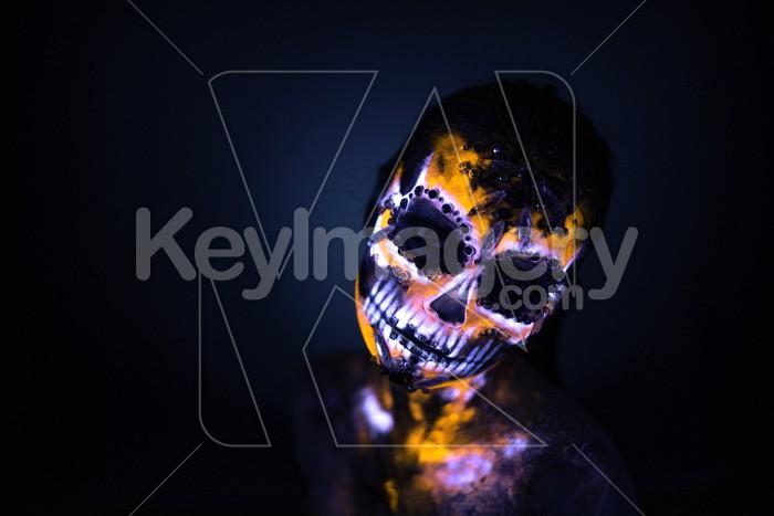Girl's face painted UV skull Photo #59600