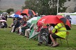 Sheltering under their brollies at the games.