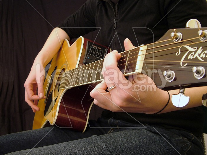 relaxing while playing guitar Photo #3001