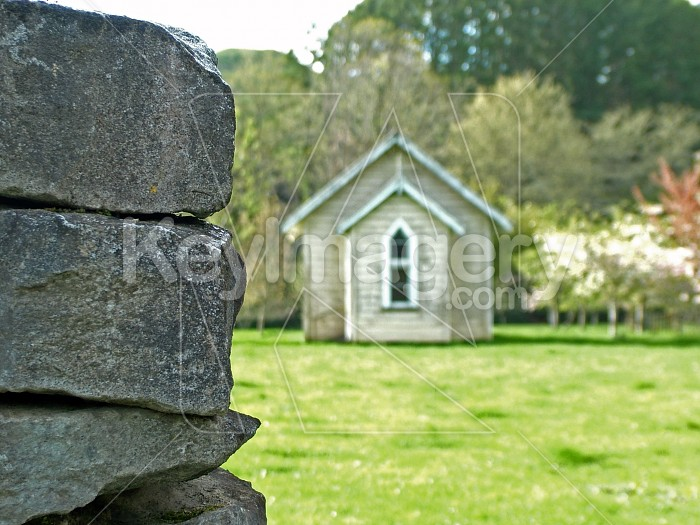 Stone fence and church Photo #4803