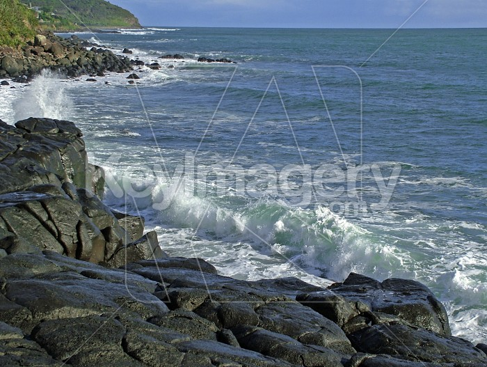 waves about to break on black rocks Photo #2292