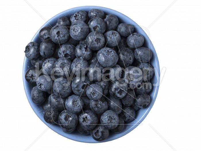 Bowl full of fresh ripe blueberries on white background. Photo #62084