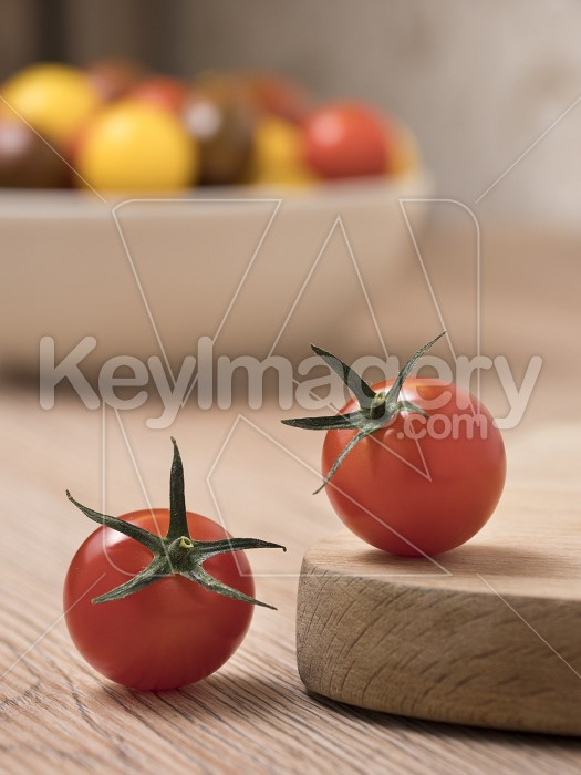 Cherry tomatoes in a variety of colors on a wooden table. Photo #59376