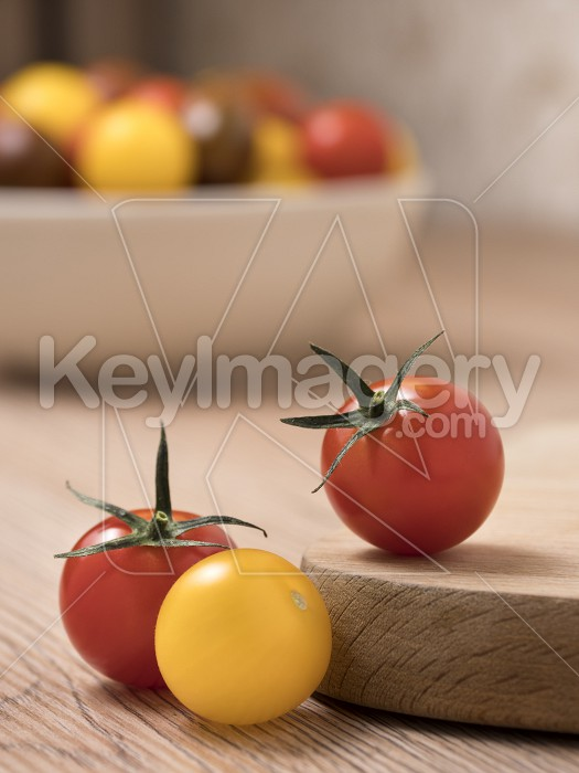 Cherry tomatoes in a variety of colors on a wooden table. Photo #59377