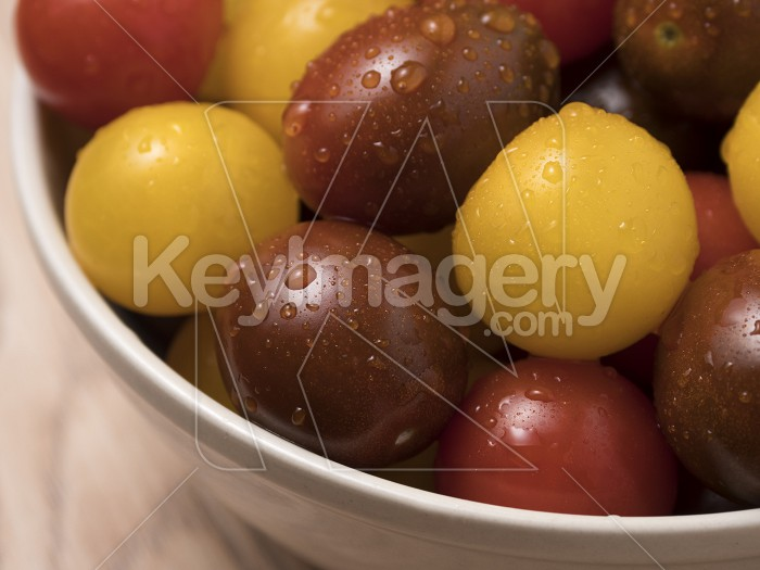 Cherry tomatoes in ceramic bowl on wooden background. Photo #59380