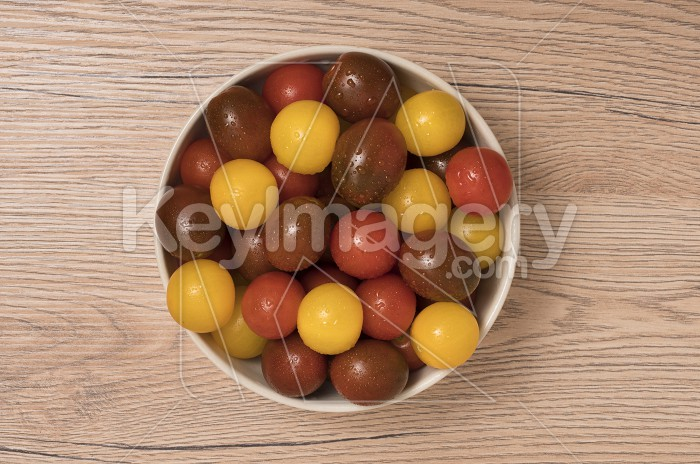 Cherry tomatoes, red,yellow and kamato in ceramic bowl on wooden Photo #59373