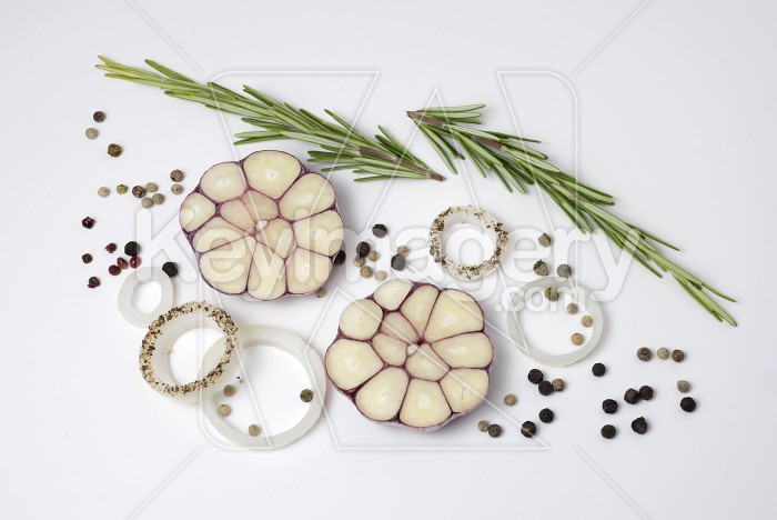 Food background of onion rings, peppercorns, rosemary and garlic Photo #62257