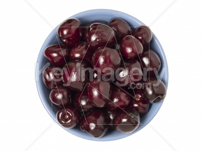 Fresh ripe cherries in bowl. Isolated on white background. Top v Photo #62046