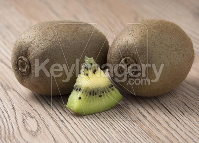 Ripe juicy kiwi fruit on wooden background. Photo #59430