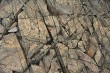 Natural stone background with cracks.